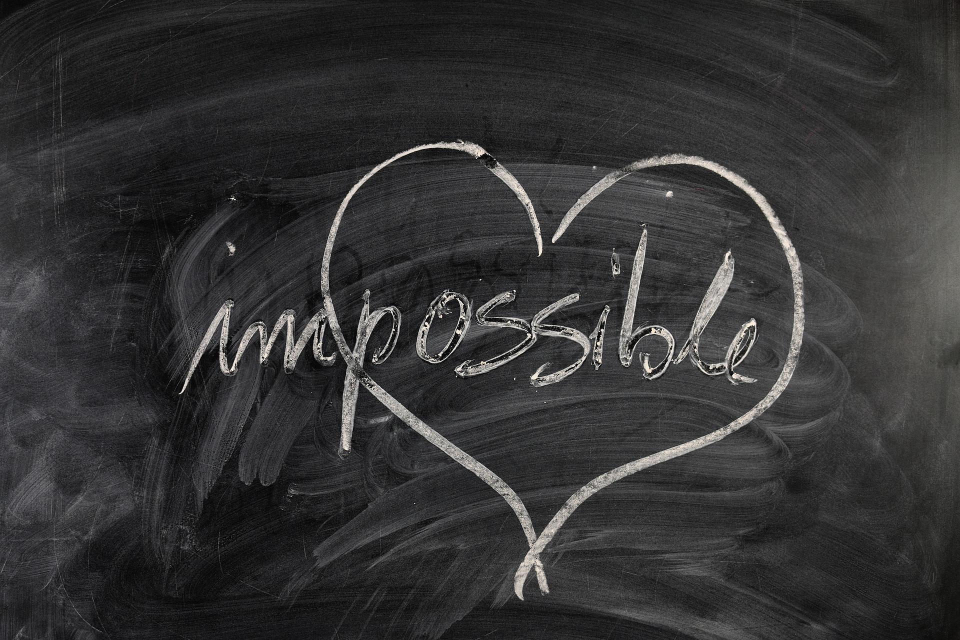 """Ordet """"impossible"""" med ett hjärta runt """"possible"""""""